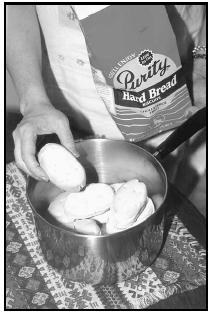 Hard Bread, not widely available in the United States, is rock-like and dry before soaking overnight in water. EPD Photos