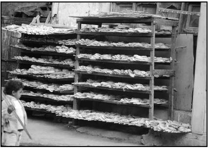A bakery displays loaves of bread on racks. Cory Langley