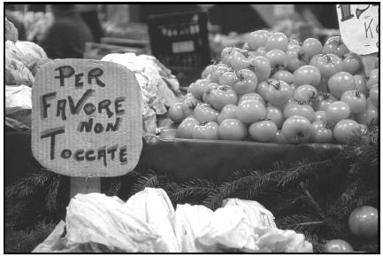 "To protect his produce from too much handling, this vendor displays a sign reading ""Please don't touch"" in Italian. Per favore is ""please."" Cory Langley"