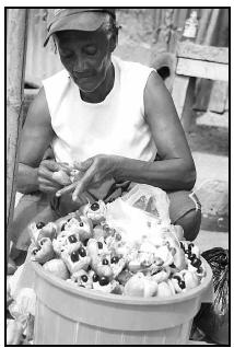 Ludel Gordon prepares ackee to sell in the Papine market in Kingston, Jamaica. Sauteed like a vegetable, the golden flesh of the ackee resembles scrambled eggs. When dried and salted codfish is added, the national dish of Jamaica, ackee and saltfish, results. When served for breakfast, it is accompanied by bammy, a fried biscuit made from ground cassava and plantains. AP Photo/Collin Reid
