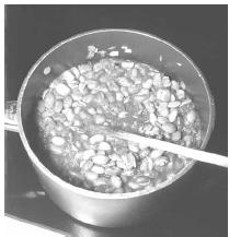 Frijoles are simmered over low heat until most the liquid has been absorbed and the beans and onion are soft. EPD Photos