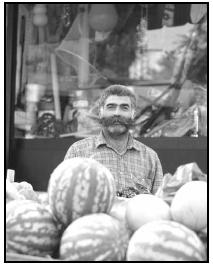 A colorful Turkish fruit vendor poses with his melons. Cory Langley