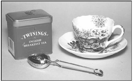 A special spoon designed to hold loose tea may be used when brewing an individual cup of tea. Most people in the UK would brew a full pot of tea at teatime. EPD Photos