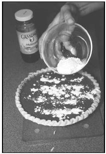 Molasses is the main ingredient in the filling for Shoofly Pie. The pie is topped with a sprinkling of reserved flour mixture. EPD Photos